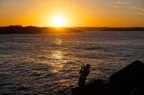 Fish on at sunset
