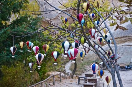 hot air balloons in tree on trail in valley of cappadocia turkey travel hiking