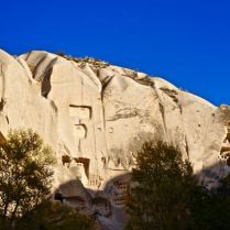 Fairy chimney carved out valley cappadocia turkey travel photography hiking rock walls